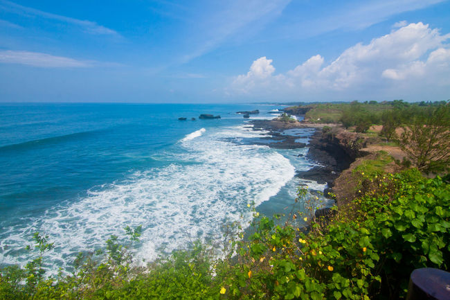 Another side of Tanah Lot Temple Bali Indonesia Beach Beauty In Nature Blue Day Horizon Over Water INDONESIA Landscape Nature No People Outdoors Palm Sand Scenics Sea Sky Tanah Tanah Lot Travel Destinations Tropical Climate Vacations Water Wave
