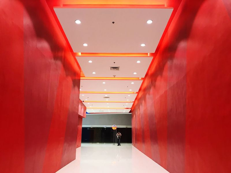 Hallway Indoors  Walking Ceiling Real People One Person Red Corridor Built Structure Architecture Leisure Activity Illuminated Lifestyles Men Modern Day People IPhoneography Iphone7