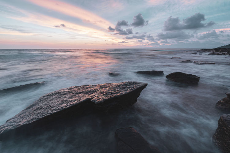 Sea Water Sky Beauty In Nature Cloud - Sky Scenics - Nature Sunset Horizon Over Water Horizon Motion Idyllic Beach Rock Land Solid Long Exposure Rock - Object Tranquility Tranquil Scene No People Outdoors Rocky Coastline