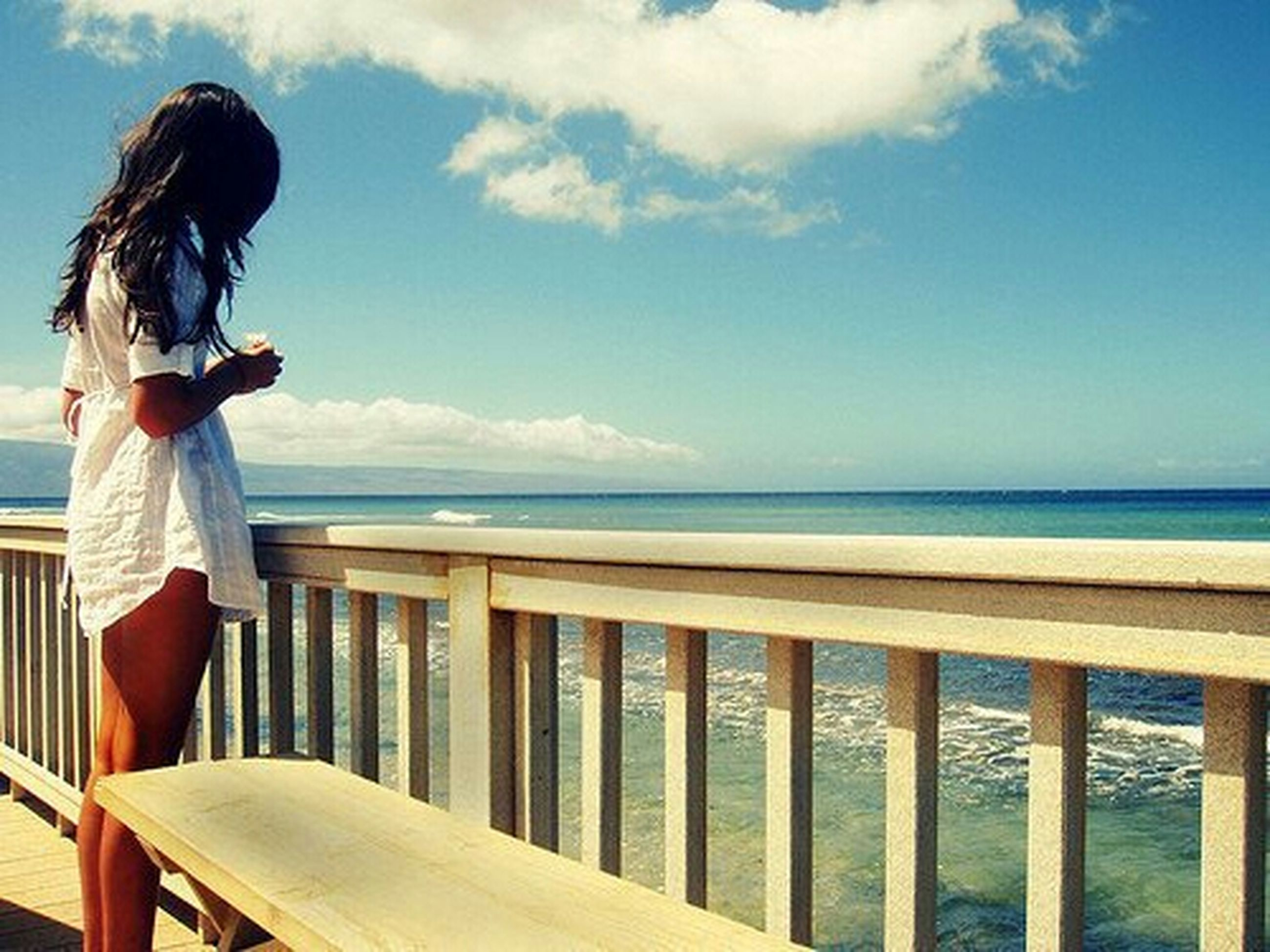 sea, horizon over water, water, lifestyles, railing, sky, leisure activity, rear view, casual clothing, standing, looking at view, scenics, beach, tranquility, nature, young adult, tranquil scene, relaxation