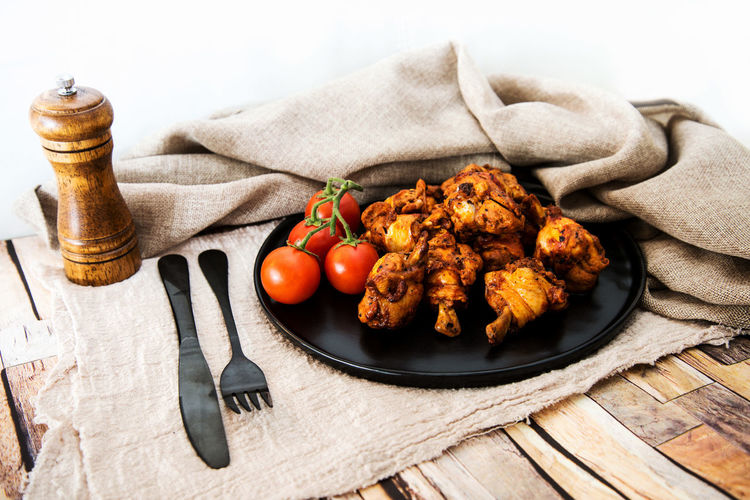 Close-up of chicken lollipops in plate on table