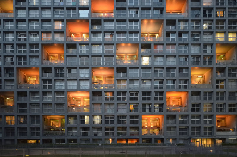 Full frame shot of apartment building at night