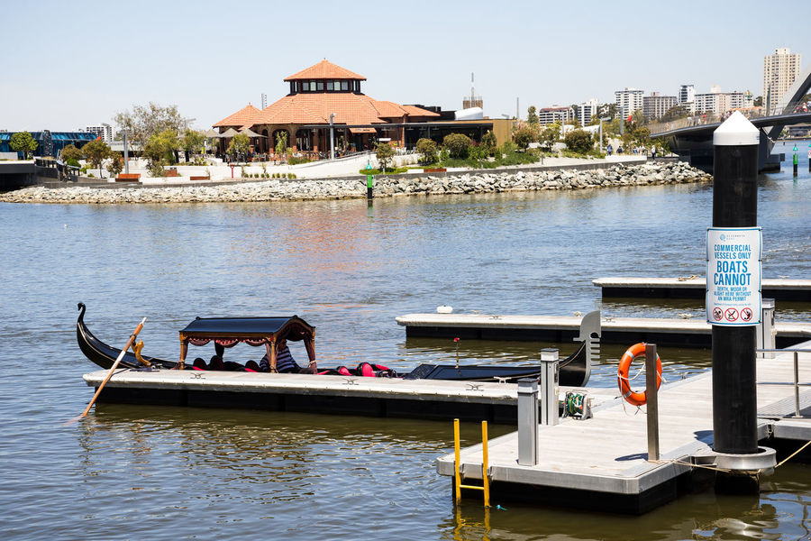 Gondola at Elizabeth Quay Jetty with Isle of Voyage restaurant on background in Perth City Australia City Elizabeth Ferry Gondola Perth Pier Romantic View Attraction Boat Cafe Hire Island Jetty Quay Ride River Summer Swan Tourism Transperth Voyage Water Western