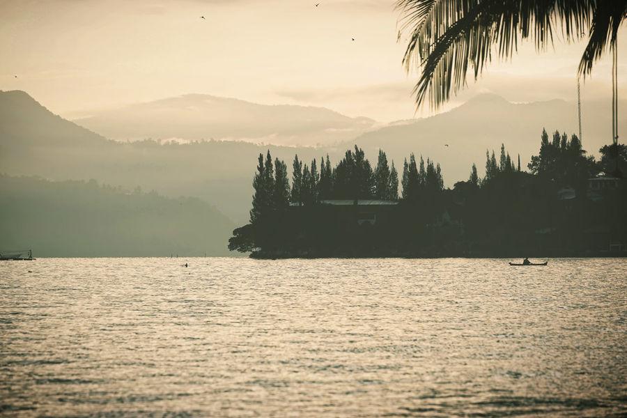 Sumatra  Toba Lake Tree Water Front  Boat Mountain Sunset Water