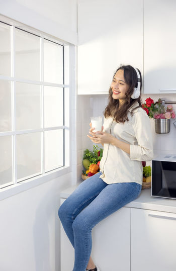 Woman holding flower at home