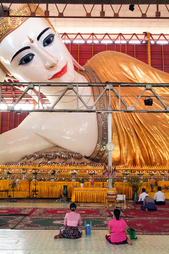 Buddha Pagoda Statue Yangon Arts Culture And Entertainment Buddhism Burma Carousel Chaukhtatgyi Day Indoors  Myanmar No People Prying Temple