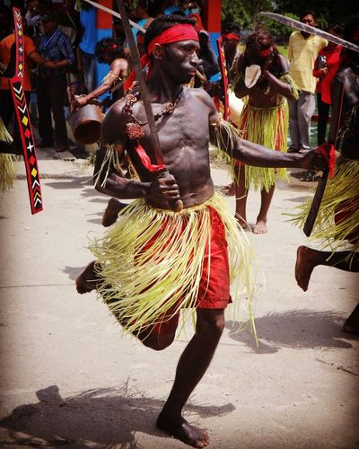Moluccan War Dance // CAKALELE Dance Arts Culture And Entertainment Cakalele Men Moluccas Outdoors People Performance Real People Sword Traditional Clothing Traditional Dancing War Dance