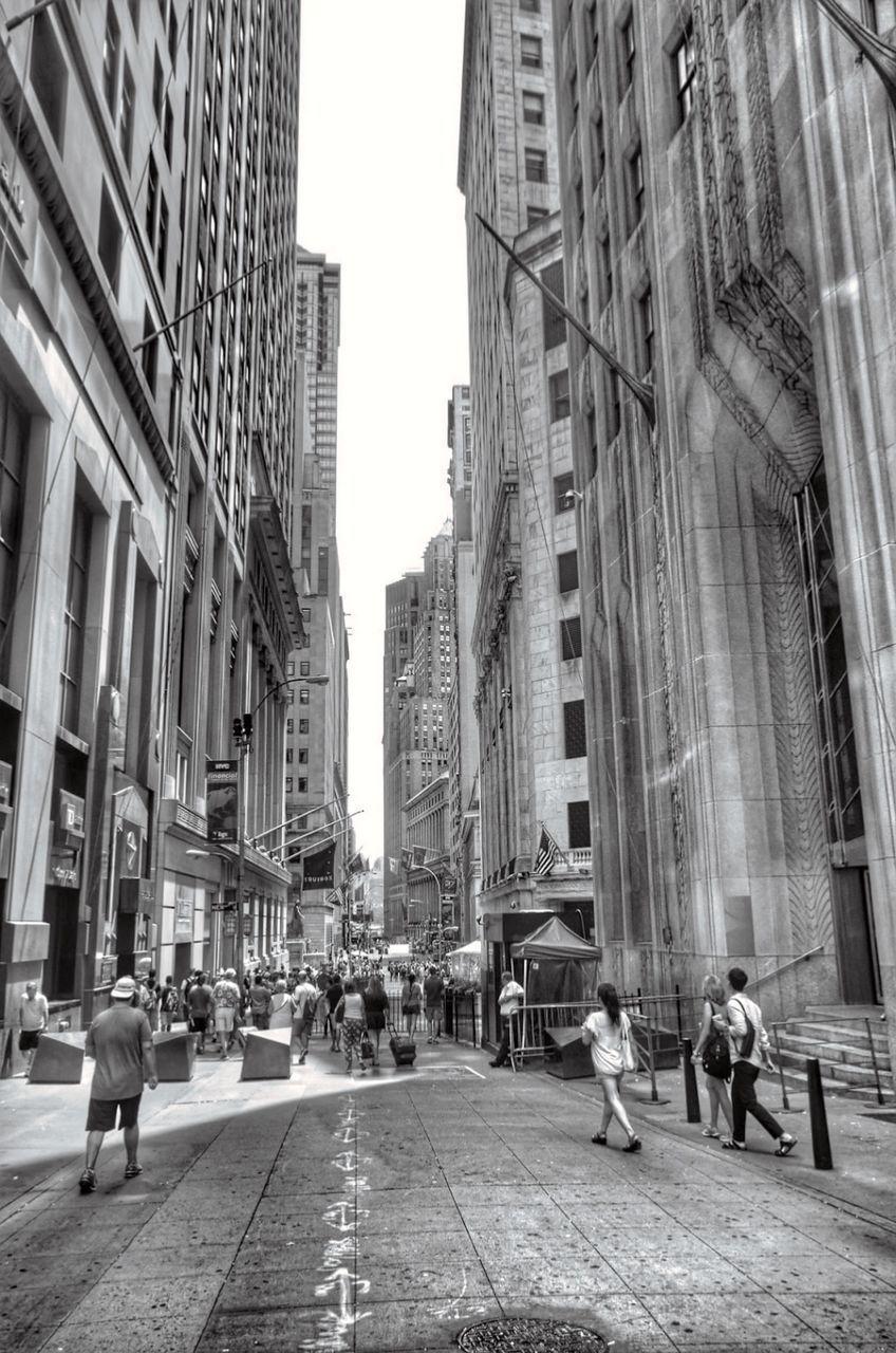 PEOPLE WALKING ON STREET IN CITY BUILDINGS