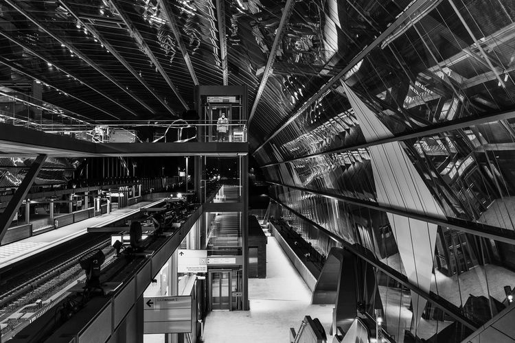 subway station Black And White Bnw Reflections Architecture Arch Indoors  Built Structure Escalator High Angle View Staircase Steps And Staircases Railing Shopping Incidental People Modern Retail  Technology Real People Metal Ceiling Night