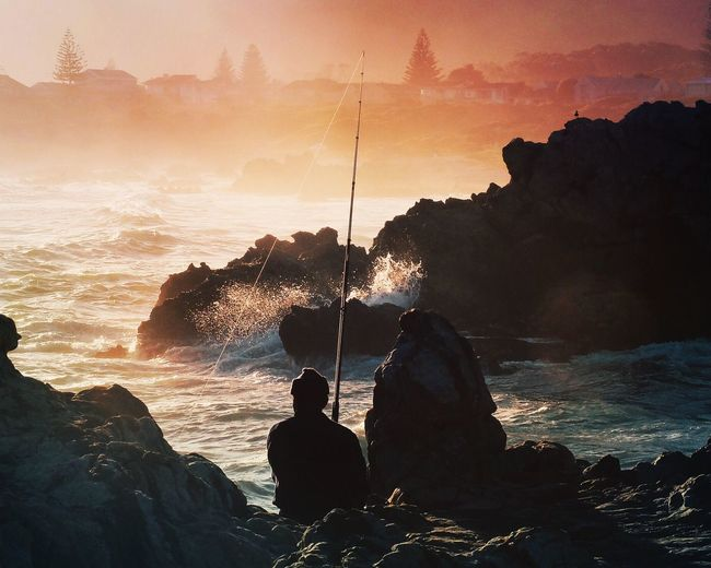 hooked {hoo kt} — noun something that attracts attention or serves as an enticement: 〰〰〰〰〰〰〰〰〰〰〰〰〰〰〰 Shot taken of a humble fisherman in Hermanus, South Africa. ? 〰〰〰〰〰〰〰〰〰〰〰〰〰〰〰 Sunset sea Sea Beach South Africa