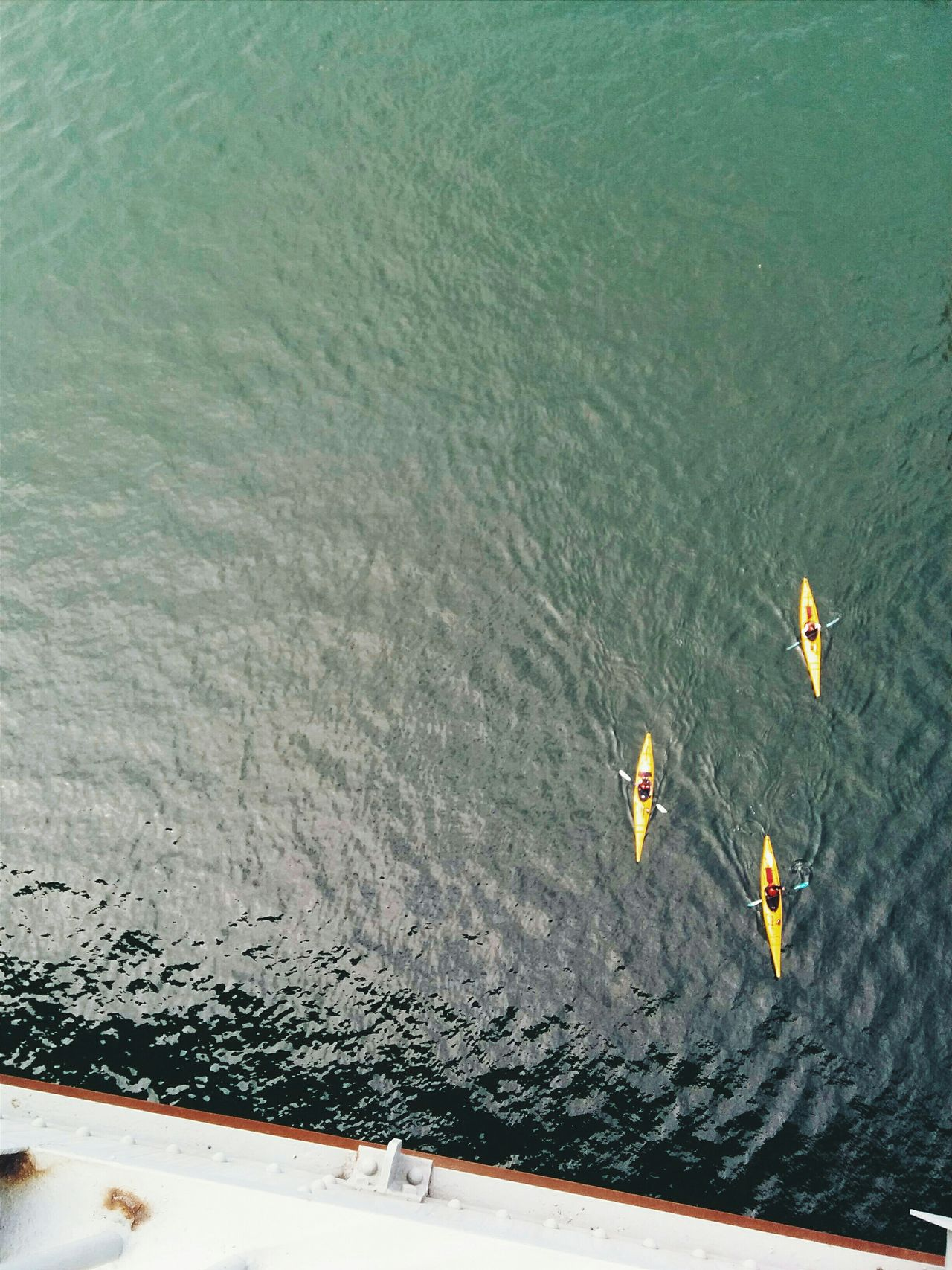 High angle view of canoes in calm water