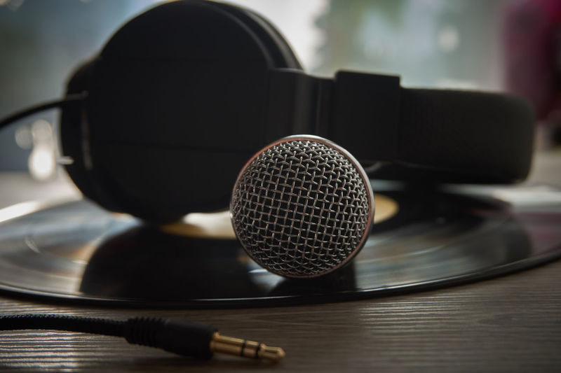 Close-up of microphone with headphones on table