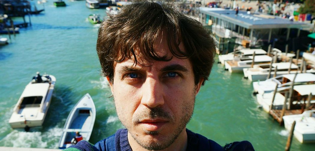 Headshot Portrait One Person Adults Only One Man Only Focus On Foreground Day Adult Only Men Looking At Camera Outdoors Young Adult Nautical Vessel Real People Harbor Men People Close-up Water Venezia Venecia Venezia Italia BYOPaper! The Street Photographer - 2017 EyeEm Awards The Portraitist - 2017 EyeEm Awards