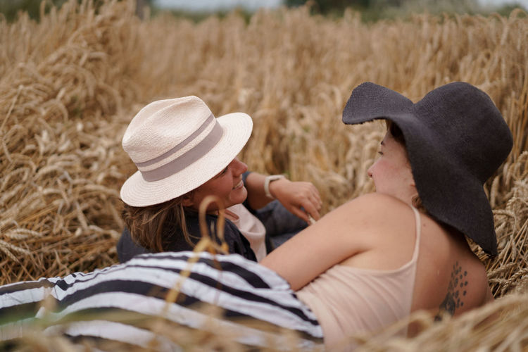 Side view of couple kissing in hat