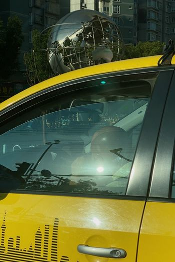Car on street seen through glass window