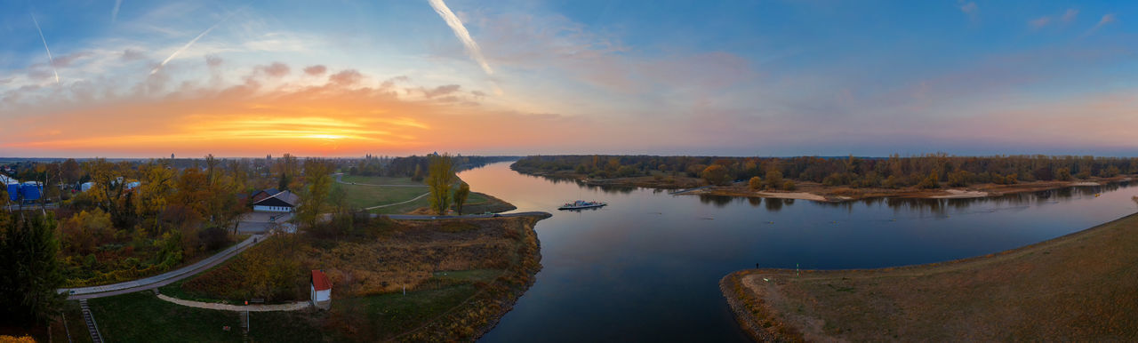 Panoramic view of river against sky during sunset