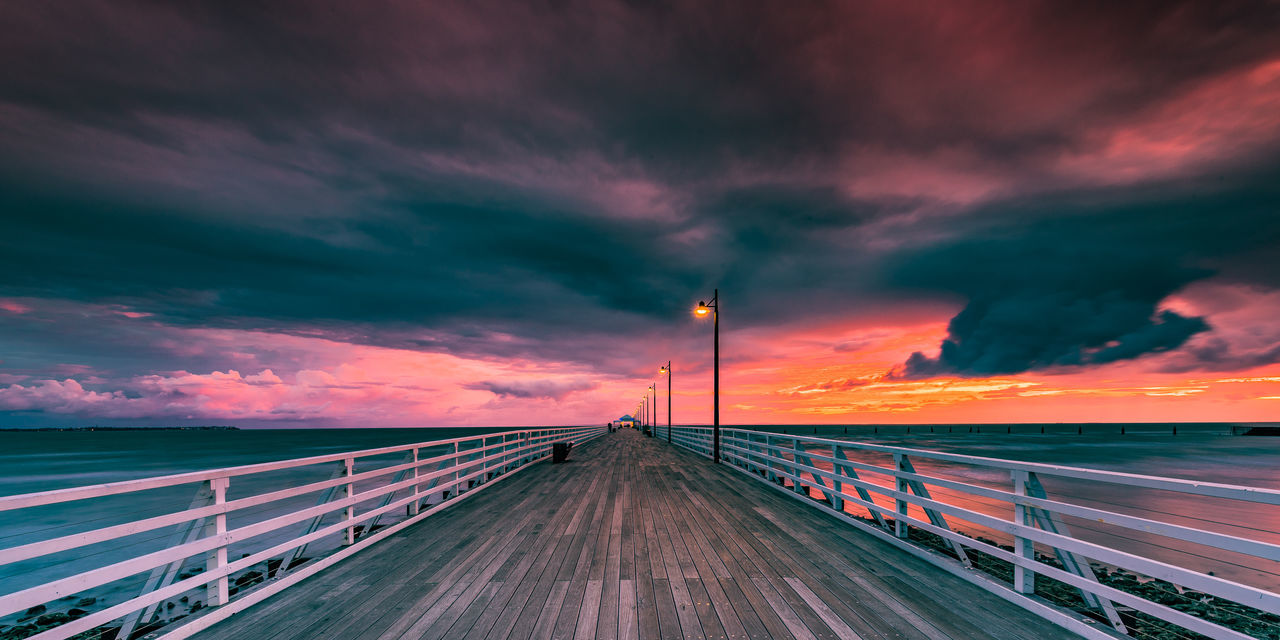 Nature Pier Sunrise_Collection Sunset_collection Beauty In Nature Bridge - Man Made Structure Cloud - Sky Clouds And Sky Dramatic Sky Eye4photography  Fineart Nature Outdoors Railing Fine Art PhotographySea Sky Sunrise Backgrounds Sunrise_sunsets_aroundworld Sunset Tranquility Pink Color Travel Destinations Water