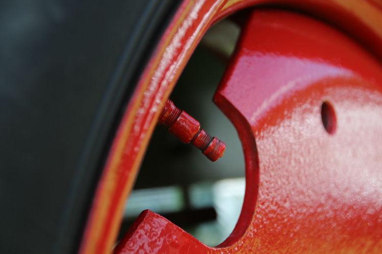 Close-up of red metallic machine