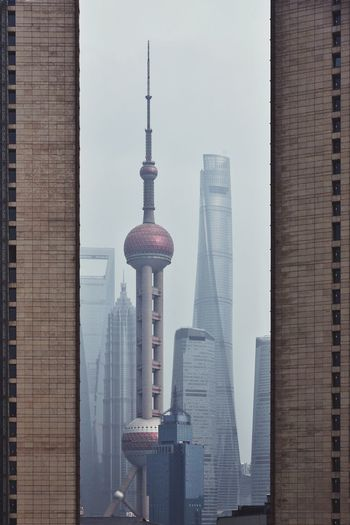 Oriental Pearl Tower And Shanghai Tower Against Sky