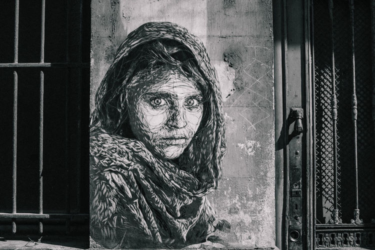 Close-up of woman against window