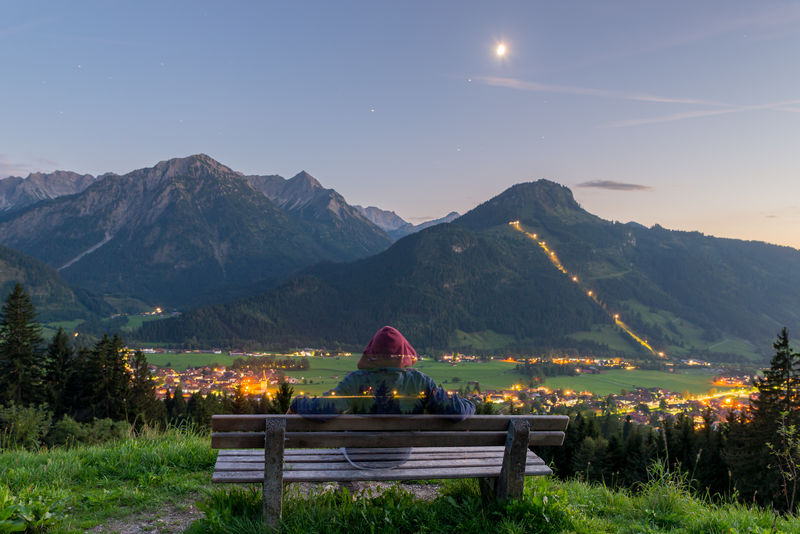 Sunset on the right and moon high above, looking over Bad Hindelang in Allgäu, Bavaria, Germany. Allgäu Bavaria Moon Nightphotography Alps Beauty In Nature Clear Sky Dreamy Leisure Activity Lifestyles Long Exposure Moon Mountain Mountain Range Nature Night Outdoors People Real People Scenics Sky Tranquil Scene Tranquility An Eye For Travel