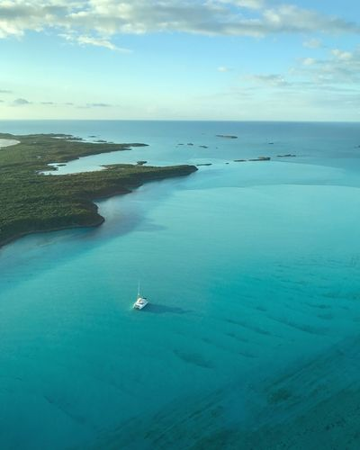 Private Bahamas anchorage Tranquil Scene Catamaran Bahamas Sailing Sea Water Nature Scenics Beauty In Nature Tranquil Scene Tranquility Horizon Over Water Sky Beach Nautical Vessel Outdoors Day