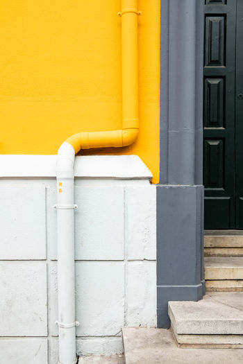 Minimalist Minimalist Architecture The Week on EyeEm Architecture Building Building Exterior Built Structure Close-up Connection Control Day House Metal Minimalism Minimalist Photography  No People Outdoors Pipe Pipe - Tube Pipeline Security Staircase Wall - Building Feature Water Pipe Yellow