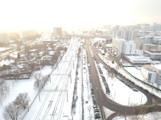 Winter Architecture Building Exterior Transportation Snow Built Structure High Angle View Travel Mode Of Transportation Cityscape No People Cold Temperature Road Building Sky Day Sunlight Nature City
