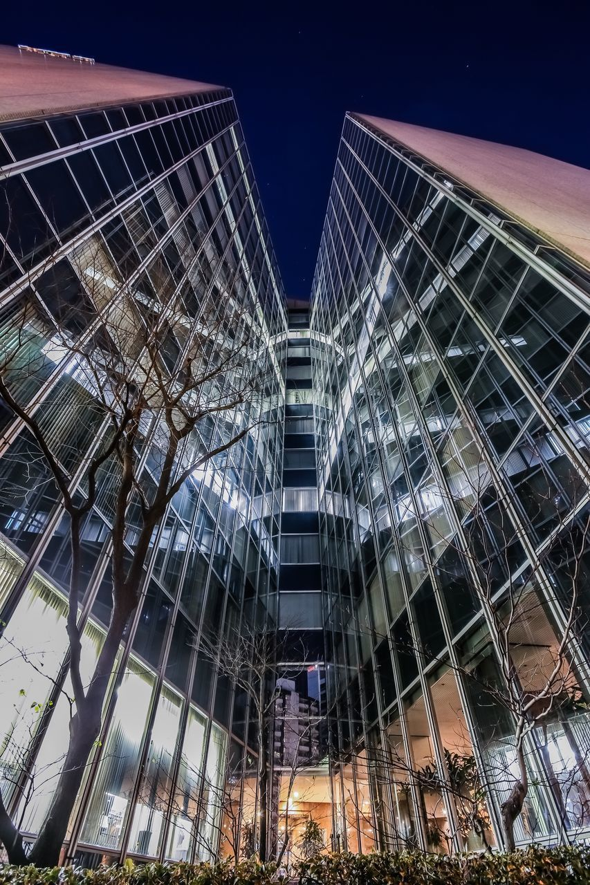 built structure, architecture, building exterior, night, low angle view, sky, modern, illuminated, no people, city, building, office building exterior, nature, tall - high, clear sky, office, tower, reflection, skyscraper, outdoors