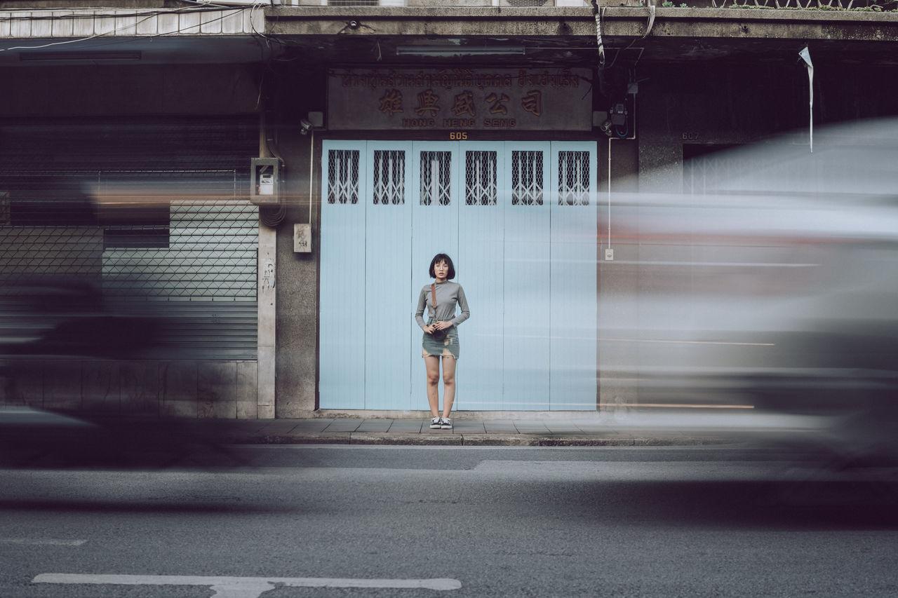 FULL LENGTH OF WOMAN ON STREET
