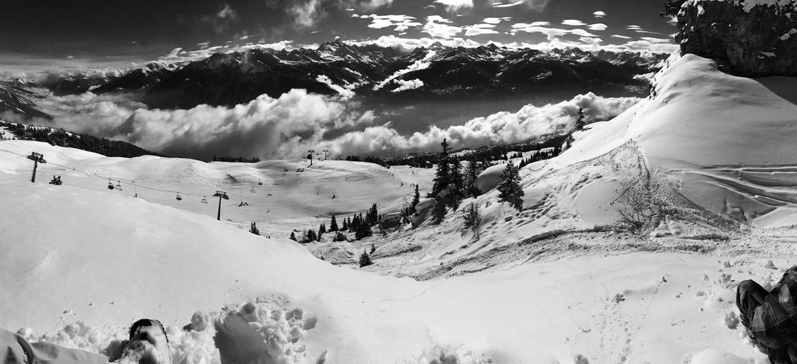 Beauty In Nature Cloud - Sky Cold Temperature Day Landscape Mountain Nature Outdoors Real People Scenics Sky Snow Snowcapped Mountain Tranquility Weather White Color Winter
