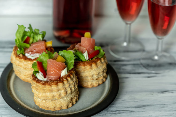 French cuisine, patties with salmon and red wine French Food Essen Healthy Eating Salmon - Seafood Appetizer Wineglass Plate Snack Savory Food Seafood Close-up Food And Drink Sandwich