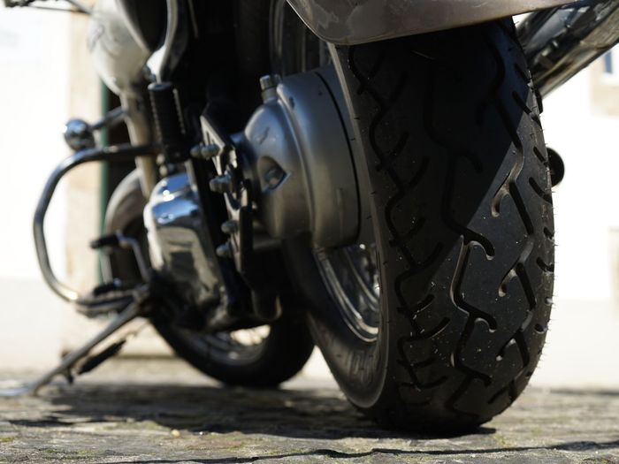 Close-Up Of Motorcycle Parked On Road