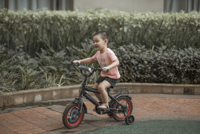 first ride, first love. Bicycle Casual Clothing Child Childhood Cute Day Focus On Foreground Full Length Girls Innocence Leisure Activity Looking Nature One Person Outdoors Real People Riding Side View Transportation Summer In The City