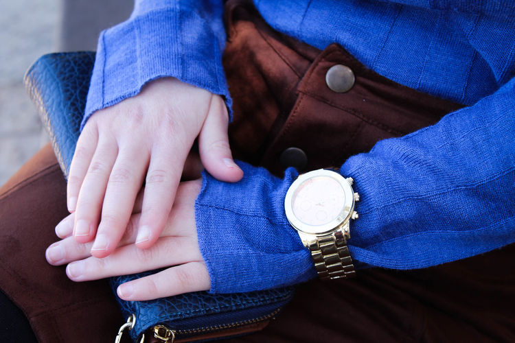 Midsection of woman with clutch bag