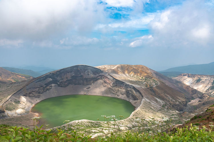 Okama crater lake at mount zao in summer sunny day. active volcano in miyagi prefecture, japan