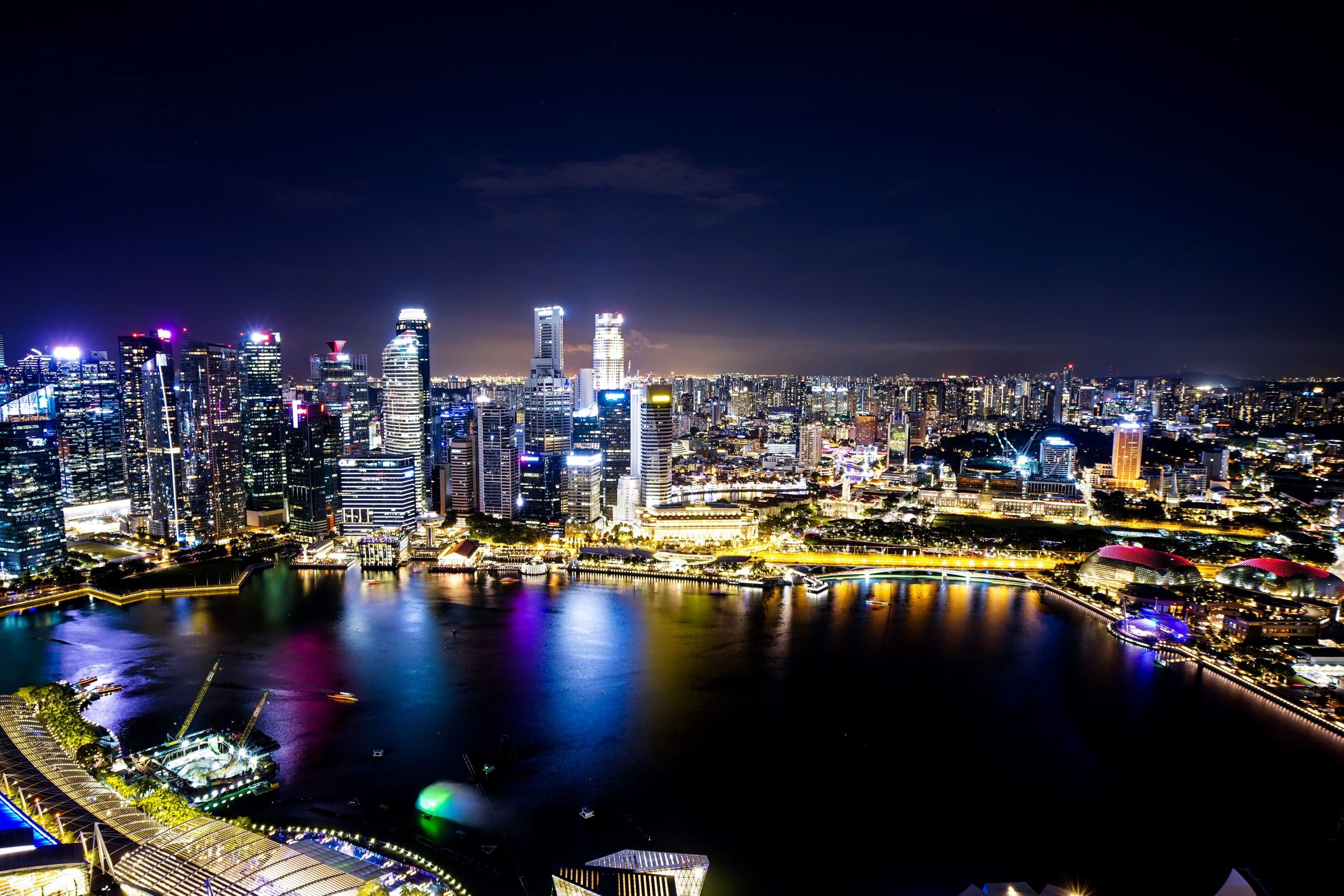 building exterior, architecture, city, built structure, building, illuminated, night, cityscape, water, office building exterior, sky, skyscraper, landscape, travel destinations, nature, modern, urban skyline, residential district, no people, outdoors
