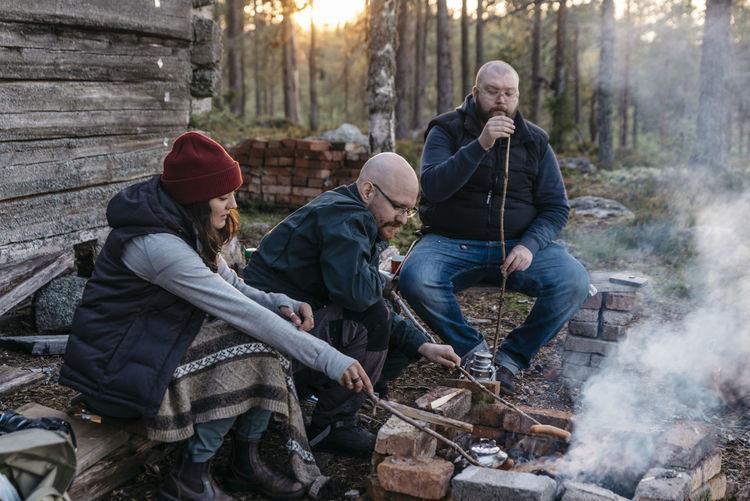 People sitting on wood in winter