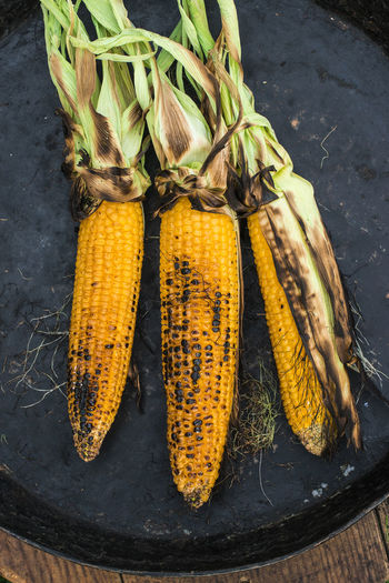 Close-up Corn Corn On The Cob Day Food Food And Drink For Sale Freshness Healthy Eating High Angle View No People Outdoors Raw Food Root Vegetable Still Life Sweetcorn Table Vegetable Vegetarian Food Wellbeing Yellow