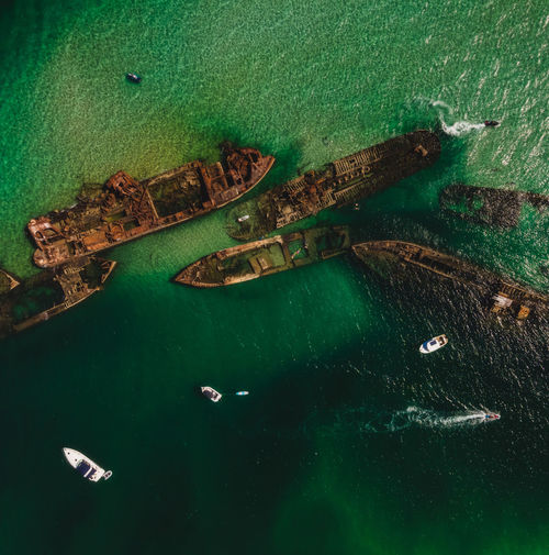 Top view drone aerial of shipwrecks in turquoise waters