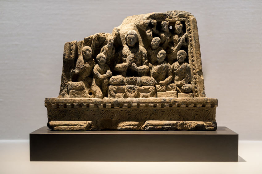 Buddhist Sculpture of Buddha's First Sermon at Sarnath Ancient Ancient Civilization Art And Craft Buddhist Carving - Craft Product Close-up Day History Live For The Story No People Outdoors Place Of Worship Religion Sarnath Sculpture Sermon Spirituality Statue Temple Travel Destinations