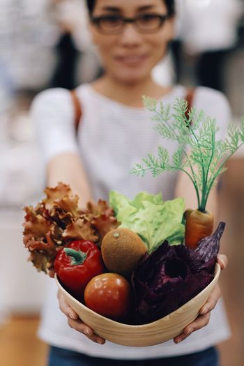 Close-Up Of Woman Holding Vegetables
