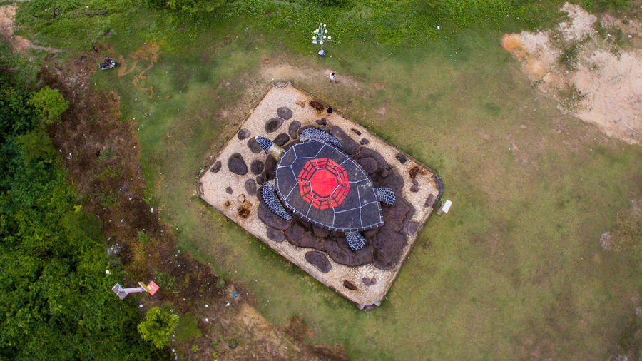 Giant Sea Turtle Statue from aerial view Bintan  Kepulauan Riau Aerial View Circle Day Directly Above Geometric Shape Grass Green Color Heart Shape High Angle View Hole Land Love Nature No People Outdoors Park - Man Made Space Patung Penyu Plant Sebong Pereh Shape Travel Destination Travel Destinations Water