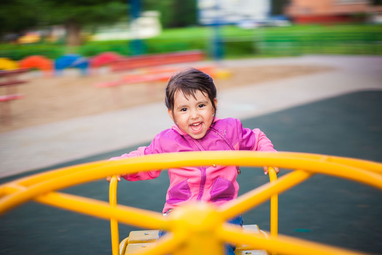 Portrait of happy girl playing in playground
