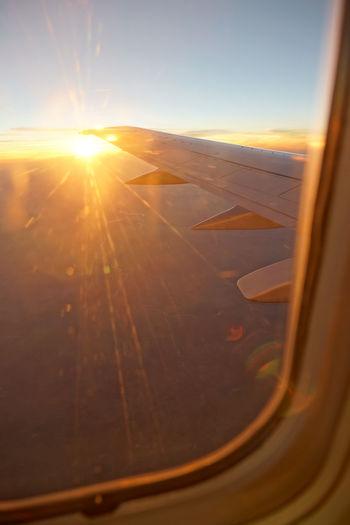 View of sunset through airplane window