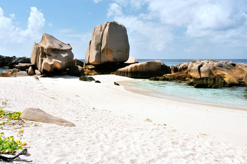 Beach Anse Marron on La Digue, Seychelles Beach Beachphotography Beauty In Nature Calm Coastline Day Destination Exotic Island Luxury Nature Ocean Outdoors Relaxed Rock Sand Scenics Sea Shore Sky Sunny Tranquility Travel Tropical Vacations