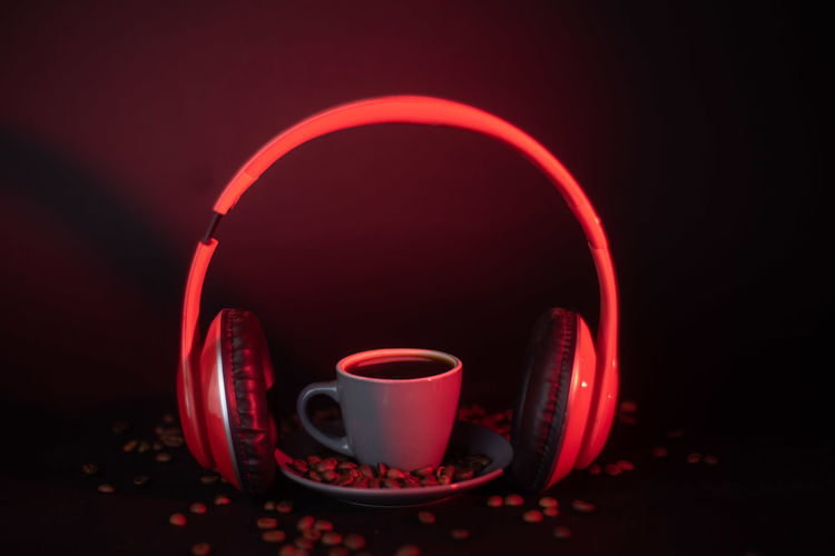 Close-up of coffee cup on table against black background