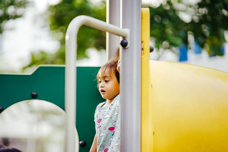 Girl standing on slide