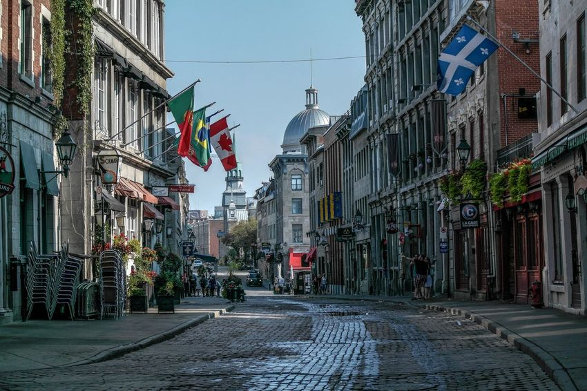 Montreal - September 2015 Chairs Flag Reflection Look Closely Selfıe Quebec Canada Montréal Flag Architecture Patriotism Building Exterior Street Built Structure Day Outdoors City Sky