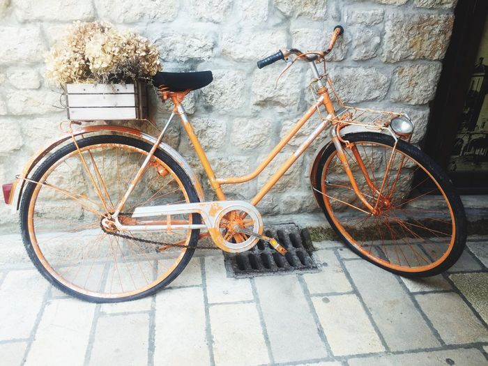Old orange bike in street Transportation Bicycle Land Vehicle Mode Of Transportation Stationary No People Day Sidewalk Street Wheel Old Parking First Eyeem Photo